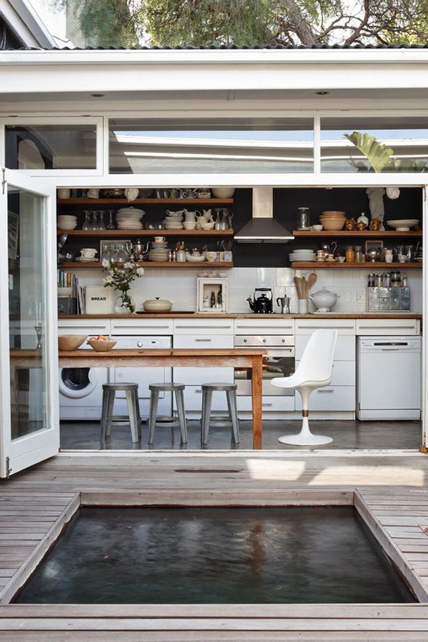 Indoor outdoor kitchen with plunge pool in Australia.