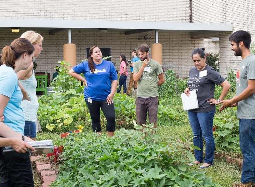 People learning in a Houston garden education class