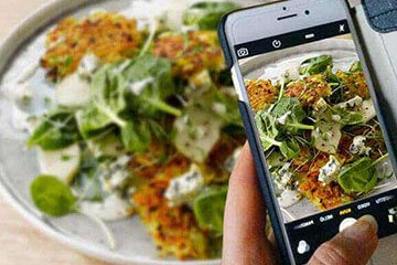 Alpro phone taking picture of veggie meal