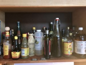 Essential oils, vinegars, and sauces get the same storage treatment as herbs and spices.