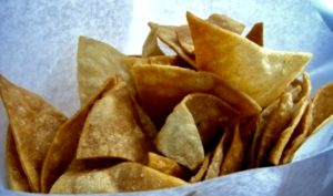 Consider frying up fresh tortilla chips with a great batch of Queso