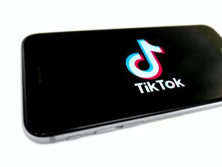 tik tok logo on phone screen
