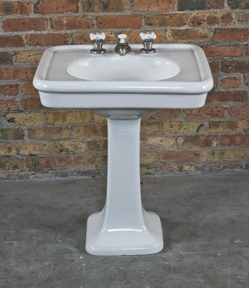 all original and intact interior residential freestanding white glazed vitreous porcelain or china lavatory pedestal sink with flared base