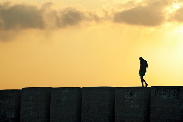 Lonely Man Walking on the Edge