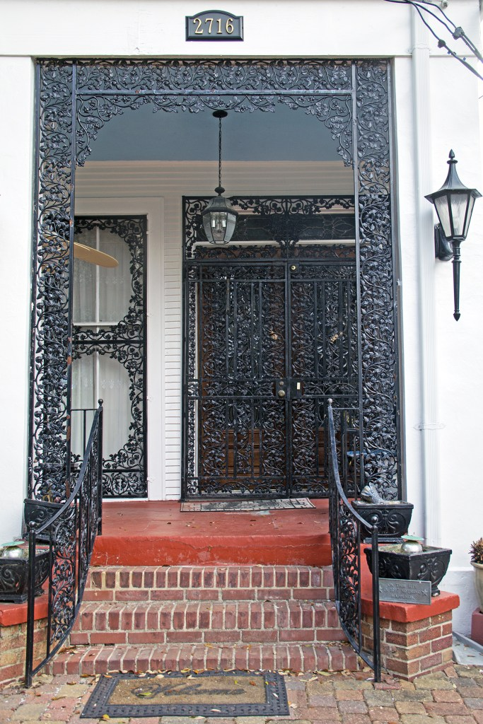 Photo of ornate iron doorway in Nola's Garden District