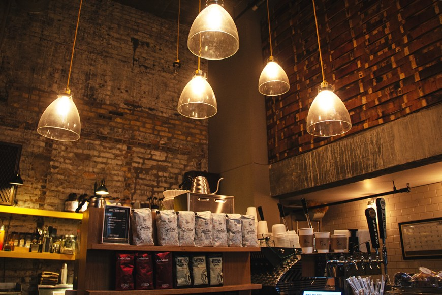 Exposed brick in the historic setting Chicago's tiny Hero Coffee Bar