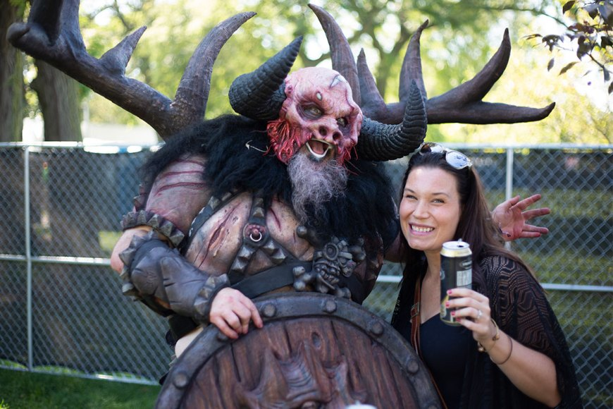 Jessica Mlinaric has a beer with GWAR
