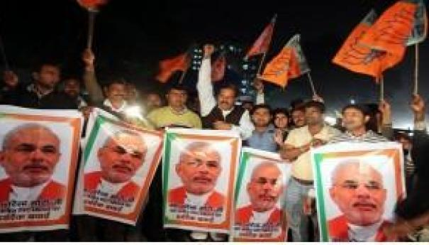 Supporters of Narendra Modi after a court rejected a petition seeking his prosecution in December 2013. EPA