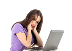 frustrated women head in hands computer laptop