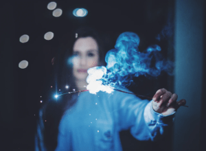 women holding burning - blue