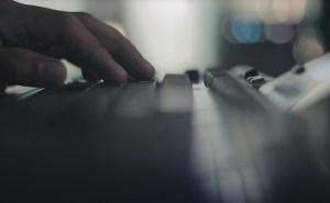 male hand on keyboard side blurred