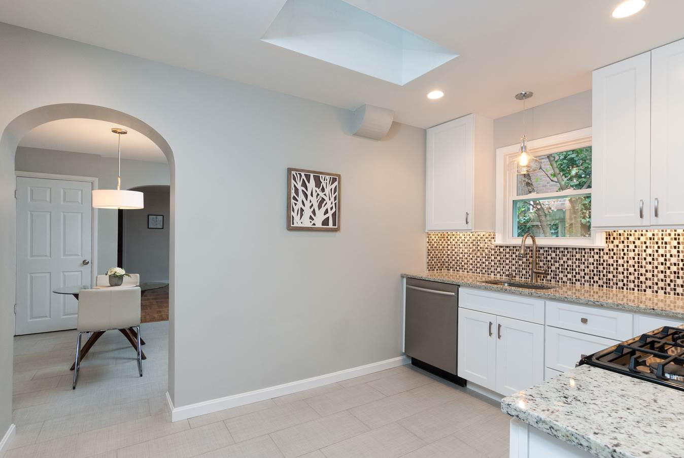 this newly remodeled kitchen brightens up the entire main level of the house and the new functional layout makes it a kitchen to enjoy for years to come - Newly Remodeled Kitchens