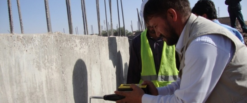 Engineer Mohammad Nadir uses a digital hammer to test the quality of concrete in Herat.