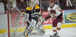 Alex Leclerc of Colorado College and Jarid Lukosevicius of Denver. Colorado College at Denver at Magness Arena, Feb. 17, 2018. (Candace Horgan)
