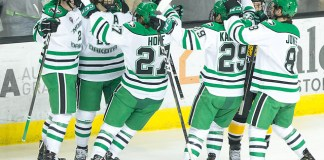 North Dakota celebrates the sweep of Colorado College. 2019 January 12 University of North Dakota hosts Colorado College in a NCHC matchup at the Ralph Engelstad Arena in Grand Forks, ND (Bradley K. Olson)
