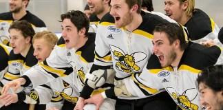 AIC players await the Atlantic Hockey championship trophy (2019 Omar Phillips)