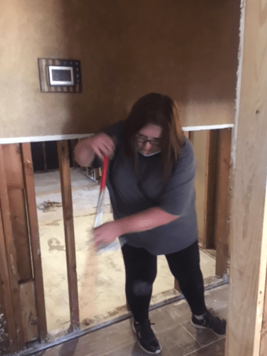 Court employee cleaning up a colleague's house.