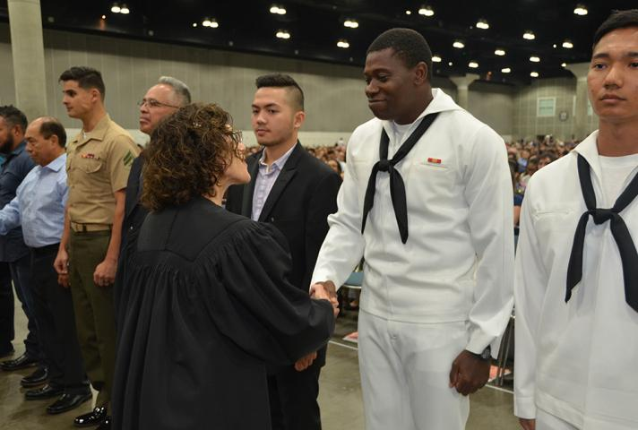 The federal court shakes hands with new citizens who serve in the military.
