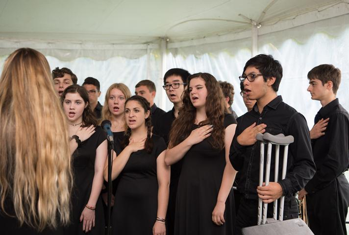 Students sing the National Anthem at a naturalization ceremony in Oyster Bay, NY.