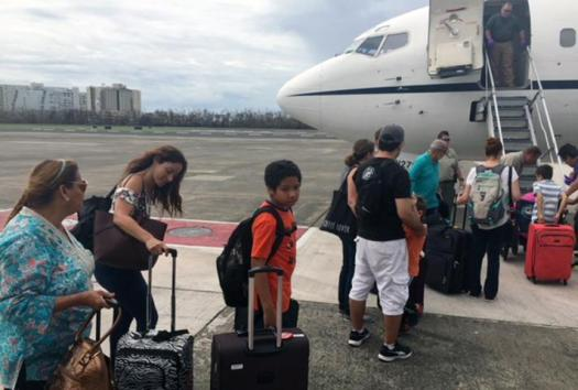 Families of federal probation officers leave Puerto Rico after Hurricane Maria.