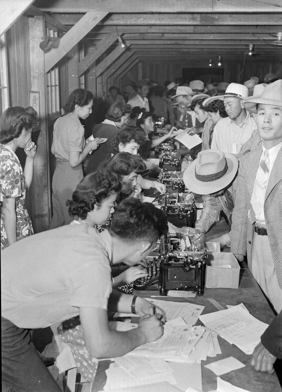 At Poston War Relocation Center, where future judge A. Wallace Tashima lived three years as a child, internees stand in registration line.