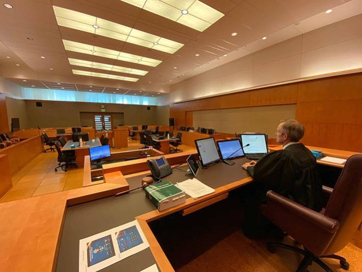 Chief Judge Philip A. Brimmer, of the District of Colorado, presiding in an empty courtroom.