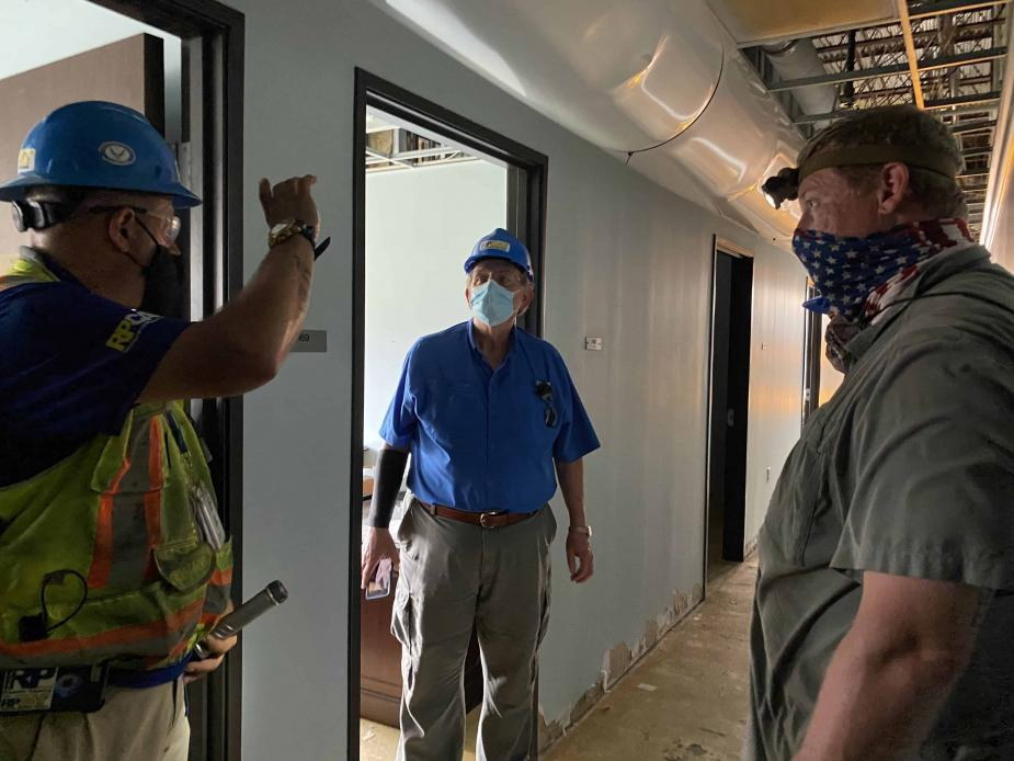 """S. Maurice """"Maury"""" Hicks (center, in blue shirt), chief Judge of the Western District of Louisiana, inspects the damaged Lake Charles courthouse."""