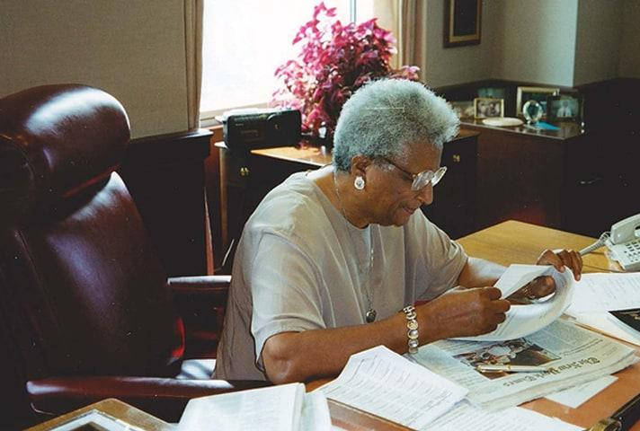 In her later years, Judge Constance Baker Motley works at her desk.