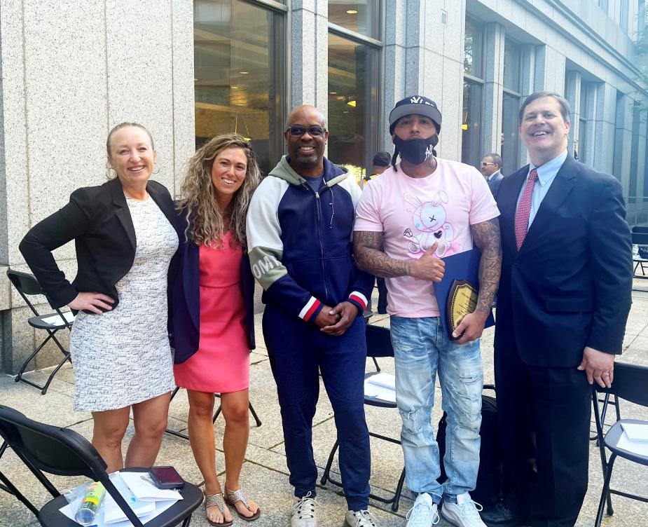 From left to right, Probation Officers Elisha Rivera and Lauren Blackford, RISE Court graduates Michael Lewis and Vincent Hernandez, and Magistrate Judge James L. Cott, of the Southern District of New York.