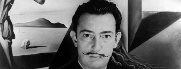 How did Salvador Dali use to capture the surreal dream images?