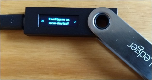 Press the right button to confirm that you want to 'configure as a new device.'