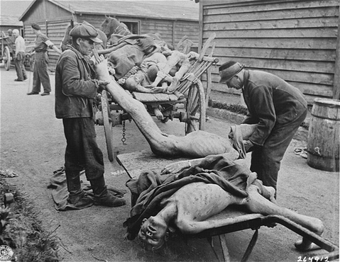 Victims of starvation are removed after U.S. troops liberated Gusen, a subcamp of the Mauthausen concentration camp. Austria, May 12, 1945.