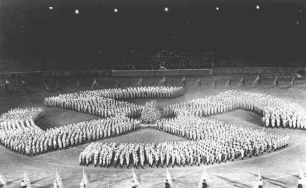 At a rally, members of the Hitler Youth parade in the formation of a swastika to honor the Unknown Soldier. Germany, August 27, 1933.