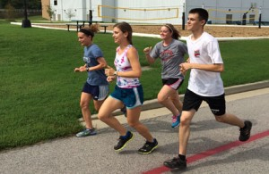 Brynne Doherty, Sara Schamber, Erica Hart and Quade Harvey run on USI's Burdette Trail Monday morning before Labor day activities.