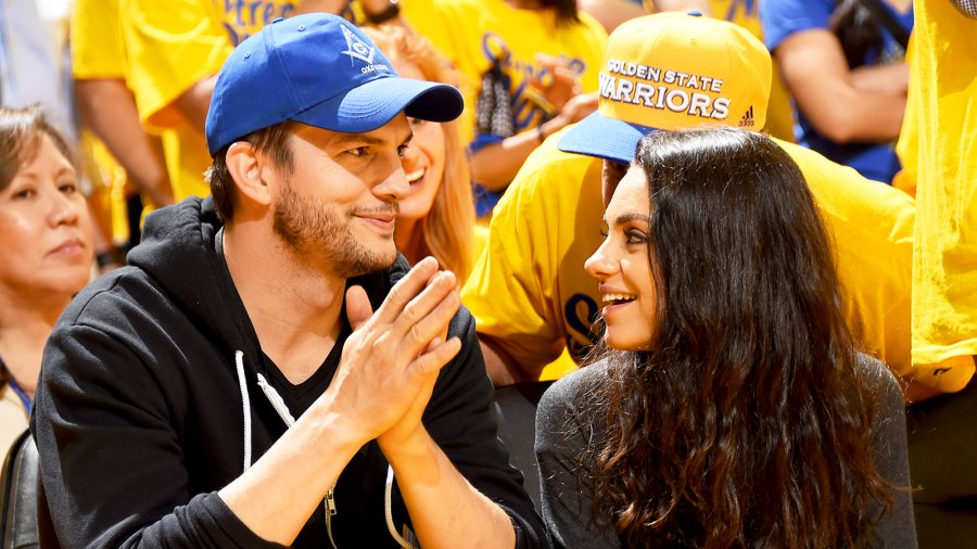 Ashton Kutcher and Mila Kunis attend Game Two of the 2016 NBA Finals at ORACLE Arena in Oakland, California.