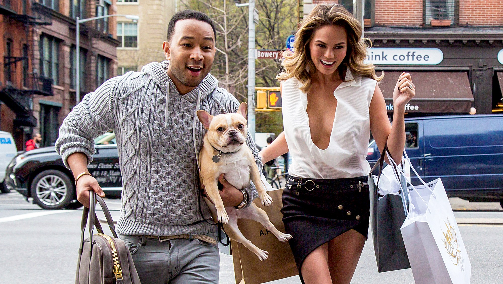 John Legend and Chrissy Teigen with their dog during a photo shoot in New York City.