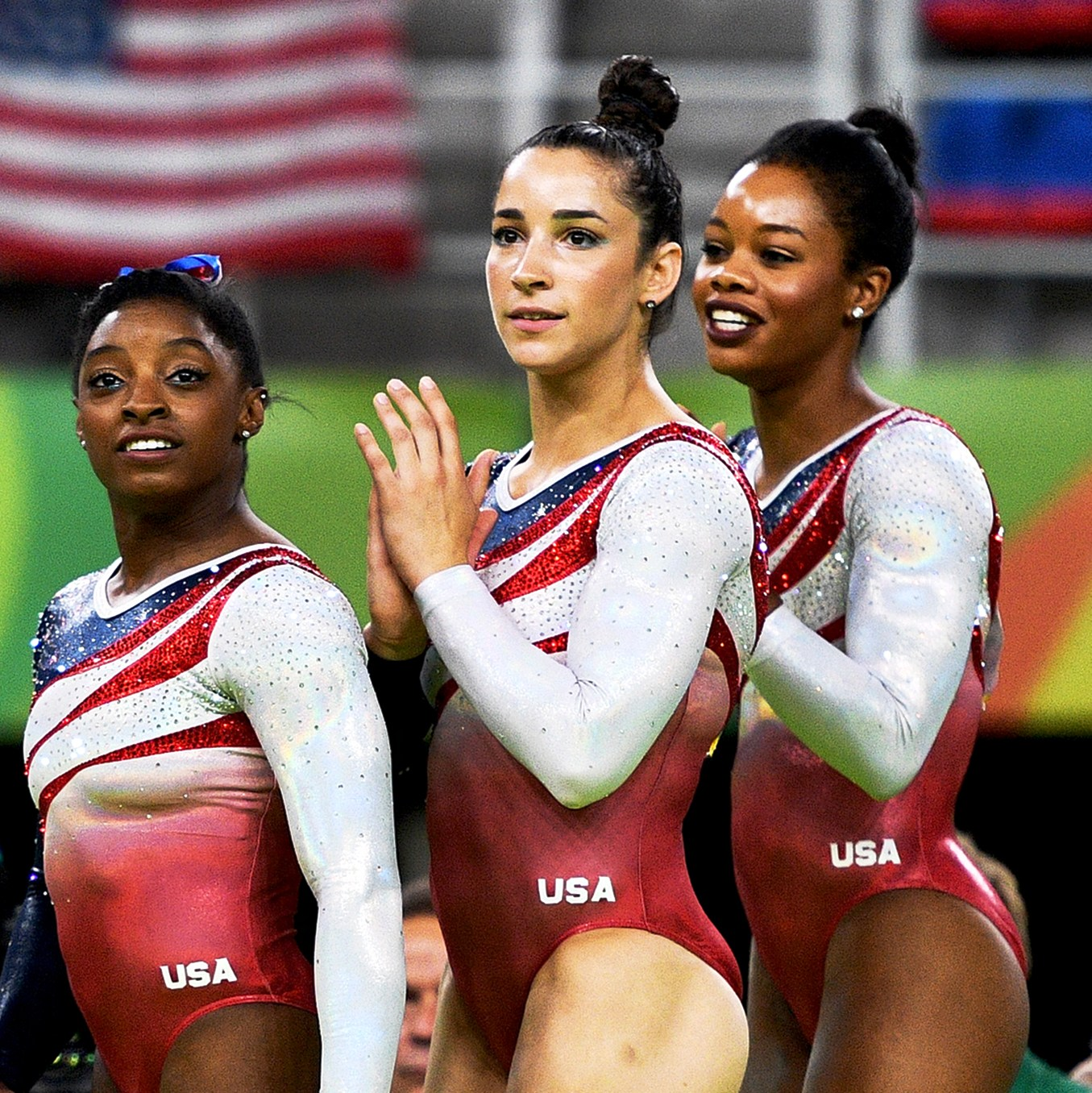 Simone Biles, Aly Raisman and Gabby Douglas of the United States celebrate winning the gold medal during the Artistic Gymnastics Women's Team Final on Day 4 of the Rio 2016 Olympic Games at the Rio Olympic Arena in Rio de Janeiro, Brazil.