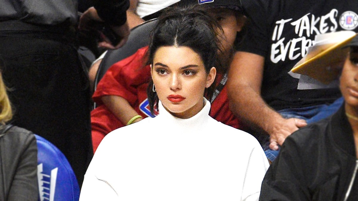 37b0881241e Kendall Jenner Wears Sparkly Saint Laurent Boots to Basketball Game