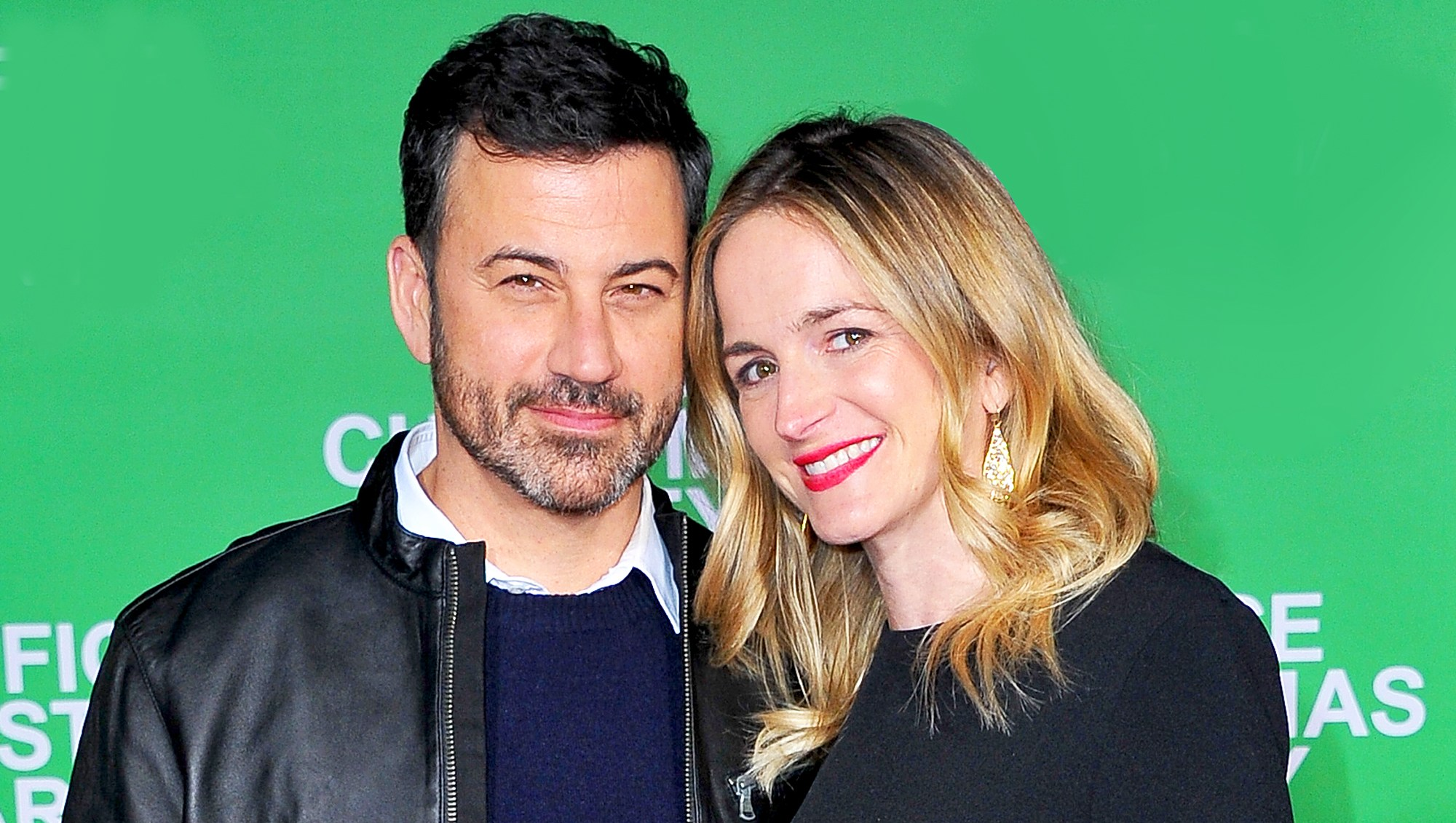 """Jimmy Kimmel and wife Molly McNearney attend the premiere of """"Office Christmas Party"""" at Regency Village Theatre in Westwood, California."""
