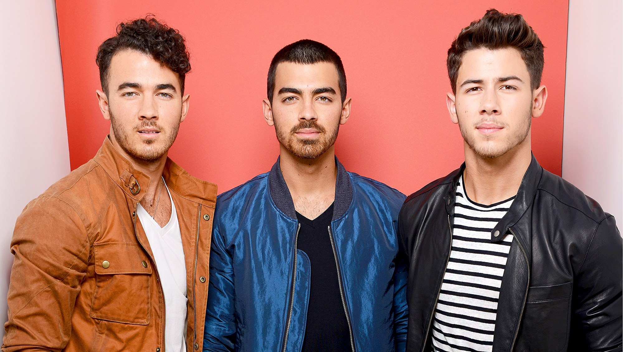 Kevin Jonas, Joe Jonas and Nick Jonas of The Jonas Brothers attend Fox Teen Choice Awards 2013 held at the Gibson Amphitheatre in Los Angeles, California.