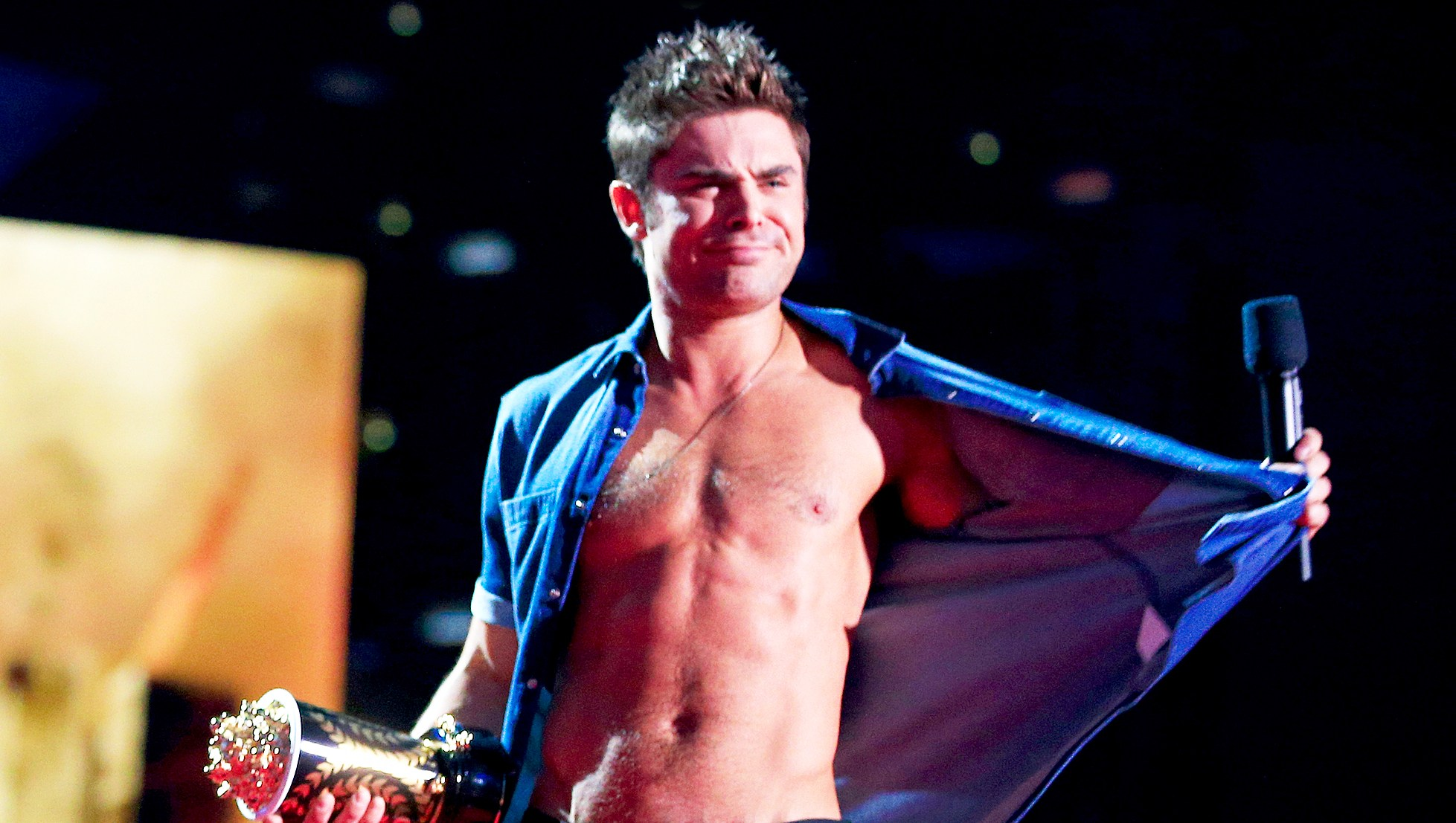 Zac Efron onstage at the 2014 MTV Movie Awards at Nokia Theatre L.A. Live in Los Angeles, California.