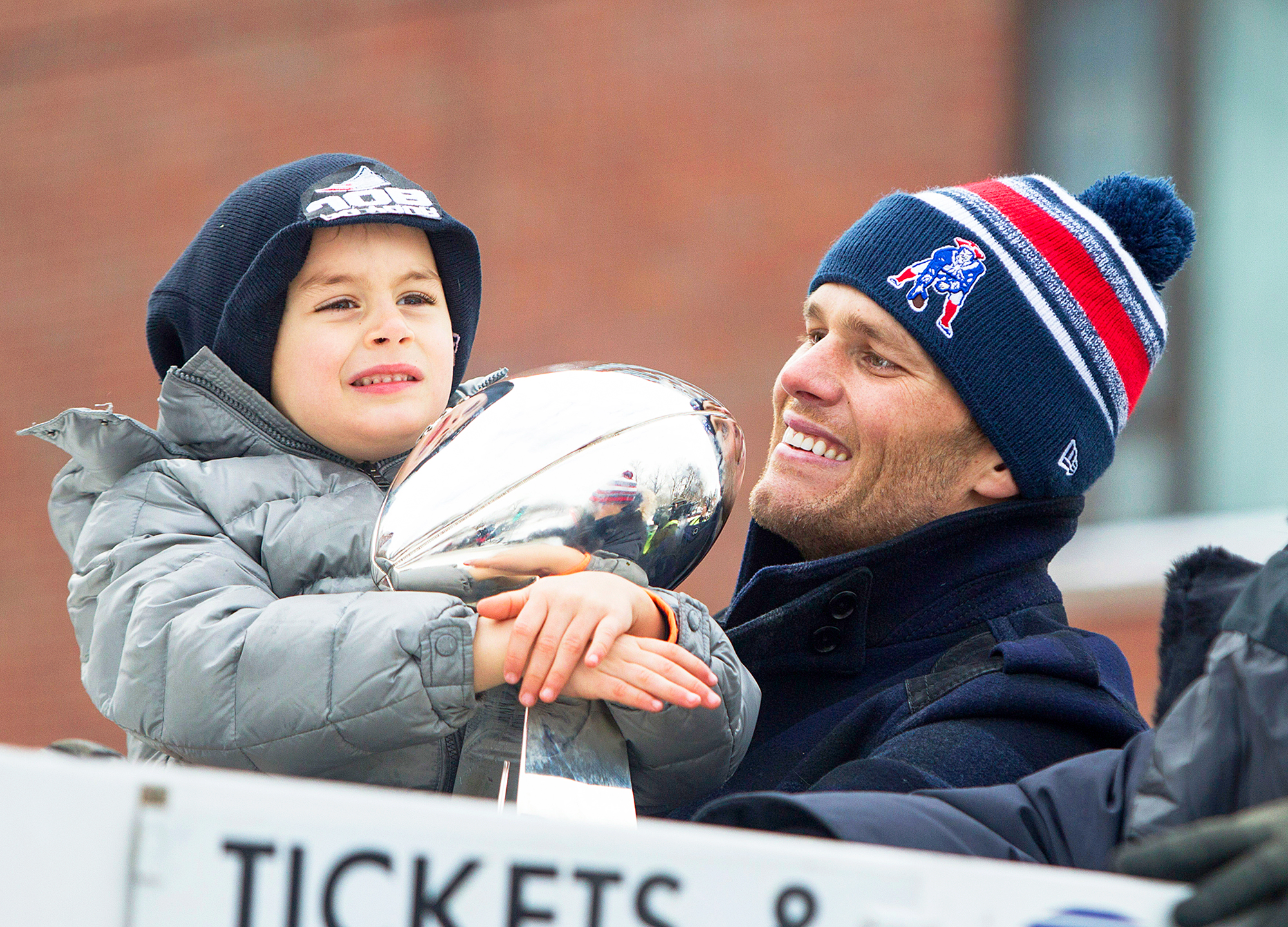 Why is it anyone's business that Tom Brady loves his son's kisses?