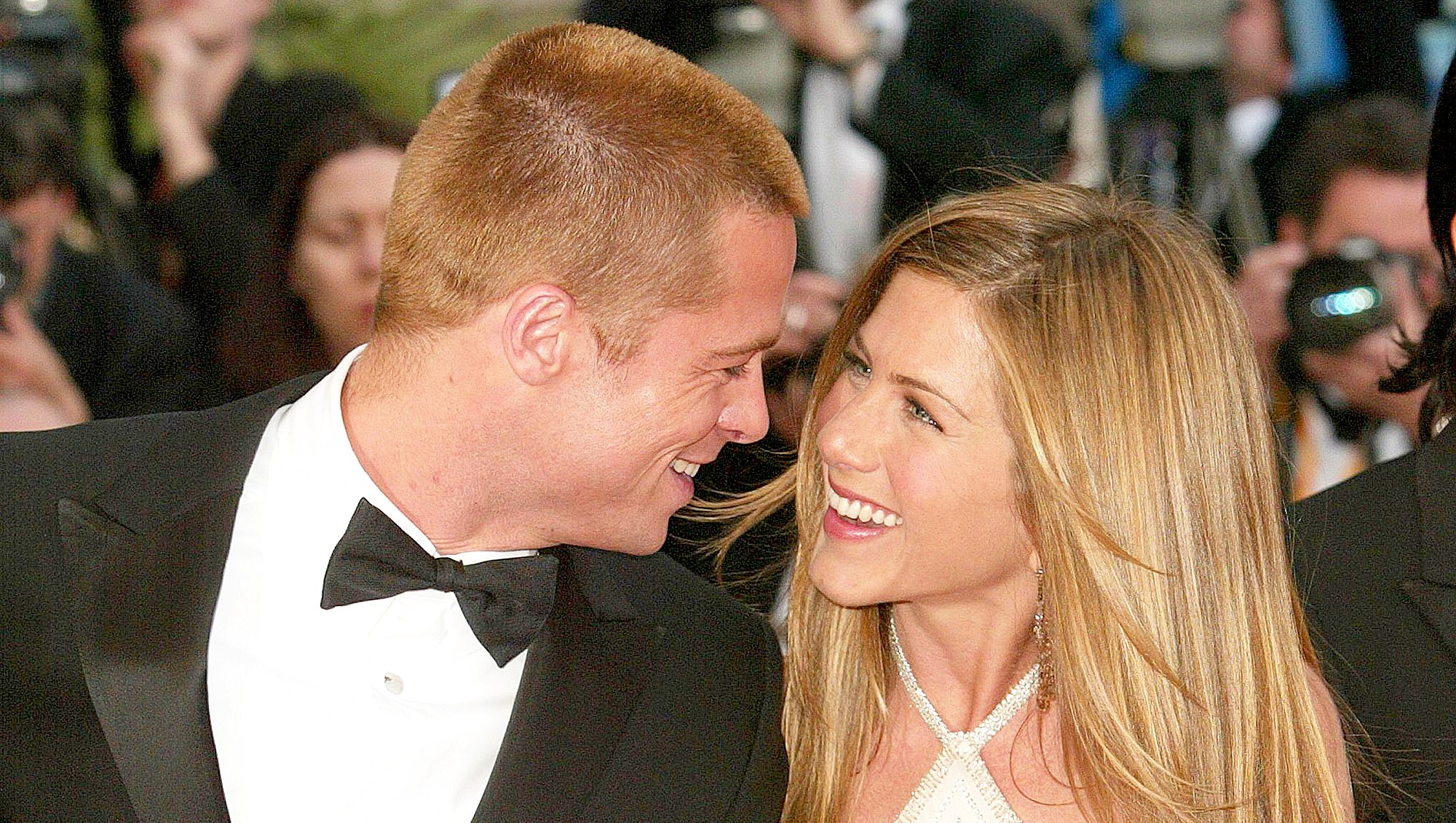 """Brad Pitt and Jennifer Aniston attend the 2004 Premiere of the epic movie """"Troy"""" at Le Palais de Festival in Cannes, France."""