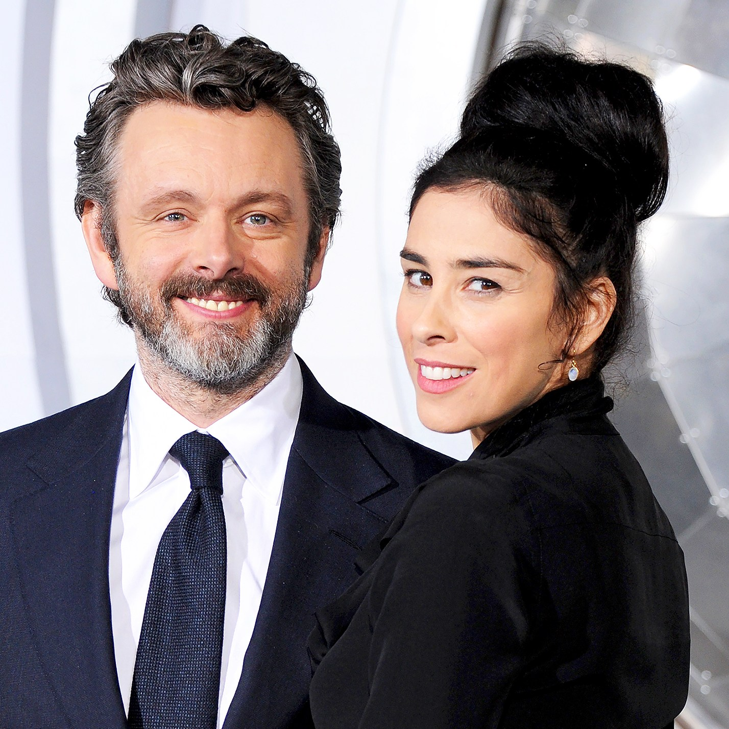 "Michael Sheen and Sarah Silverman arrive at the 2016 premiere of ""Passengers"" at Regency Village Theatre in Westwood, California."