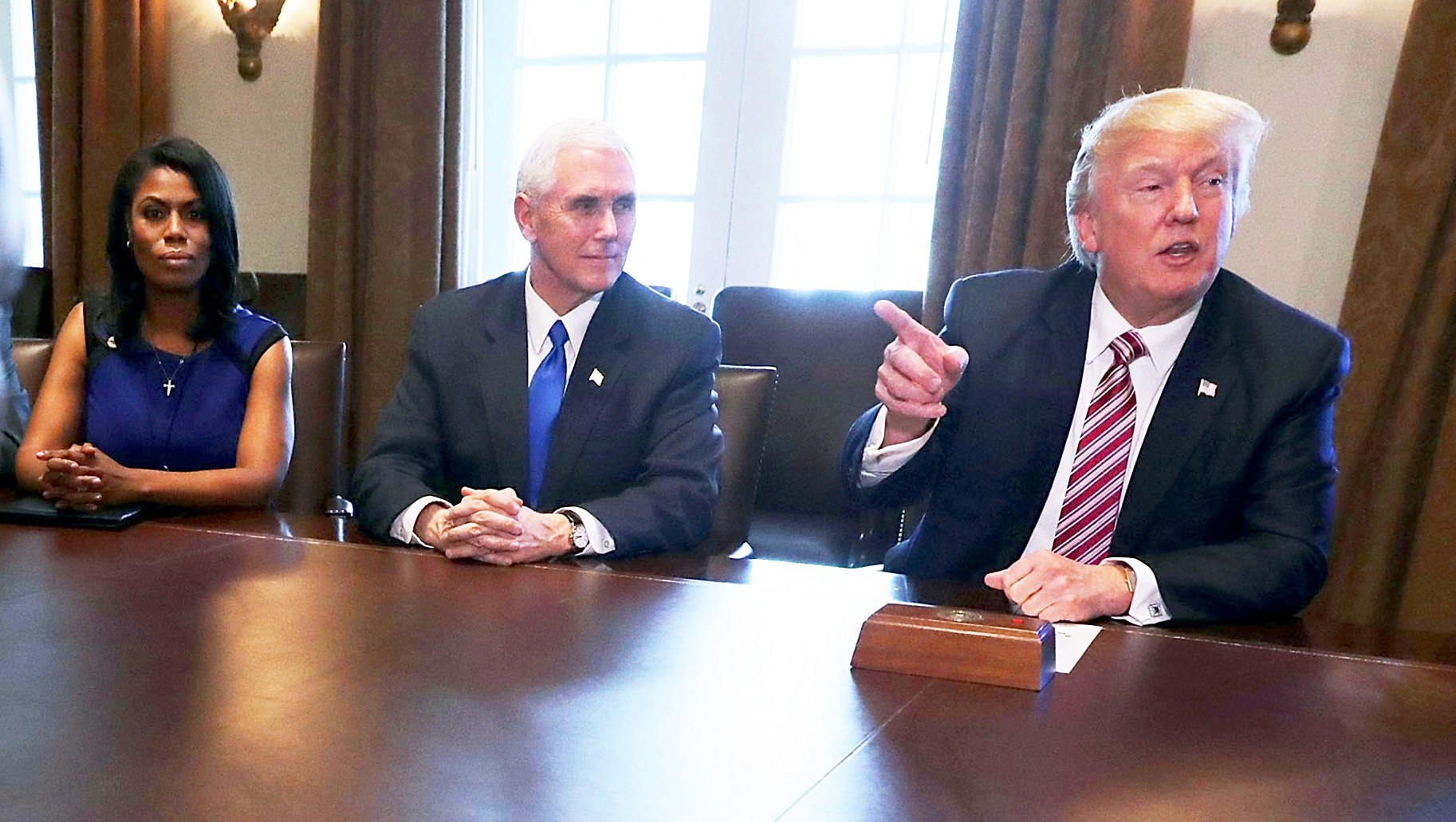 Omarosa Manigault, Mike Pence and Donald Trump during a meeting with the Congressional Black Caucus Executive Committee in the Cabinet Room at the White House March 22, 2017 in Washington, DC.