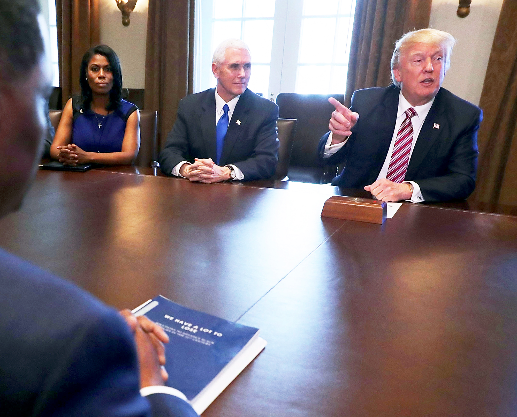 Omarosa Manigault, Mike Pence and Donald Trump during a assembly with the Congressional Black Caucus Executive Committee in the Cabinet Room at the White House Mar 22, 2017 in Washington, DC.