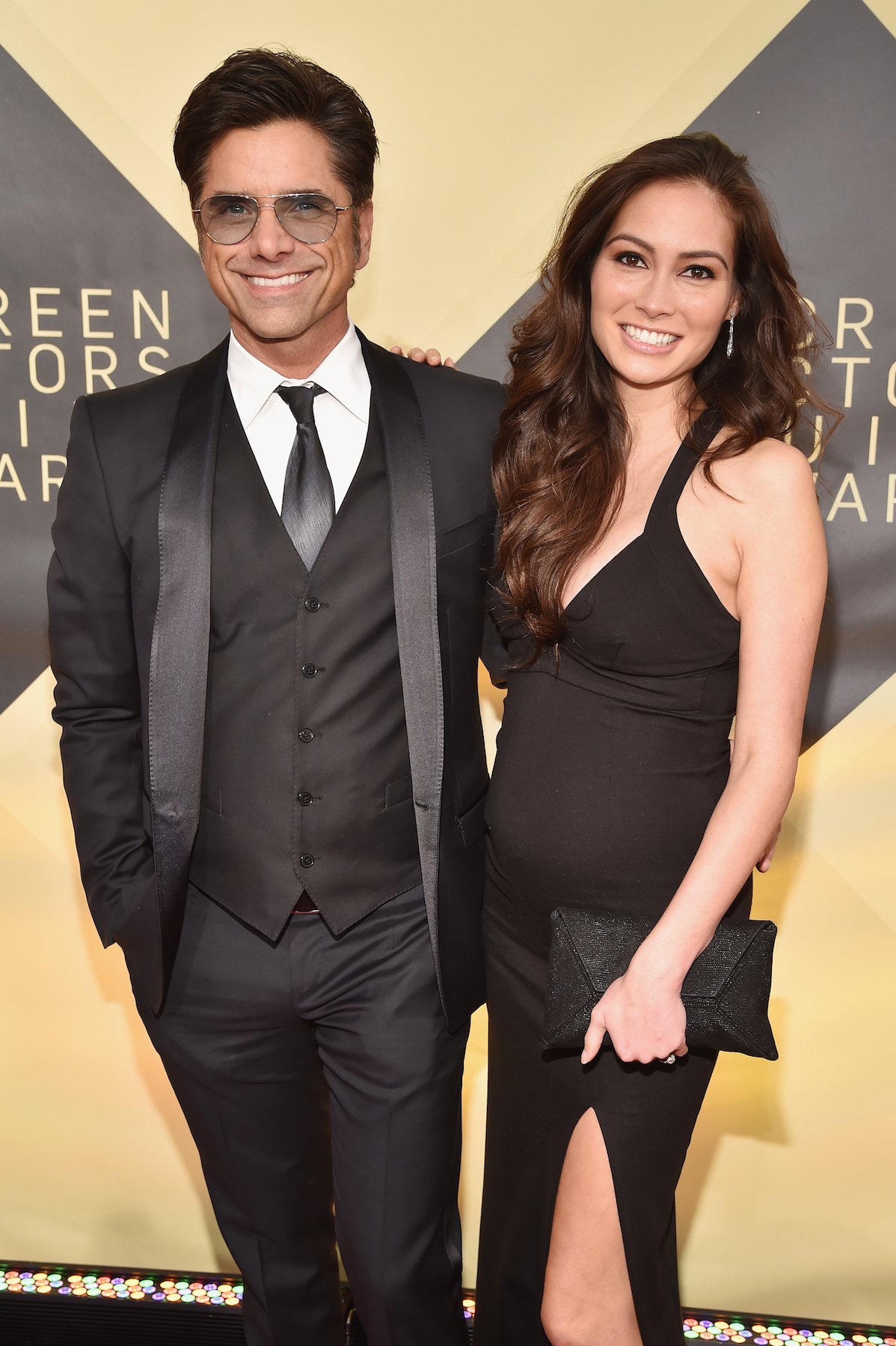 How old is john stamos now dating