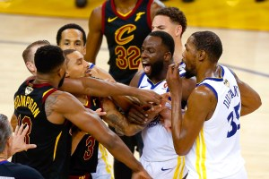 Tristan Thompson #13 of the Cleveland Cavaliers and Draymond Green #23 of the Golden State Warriors exchange words