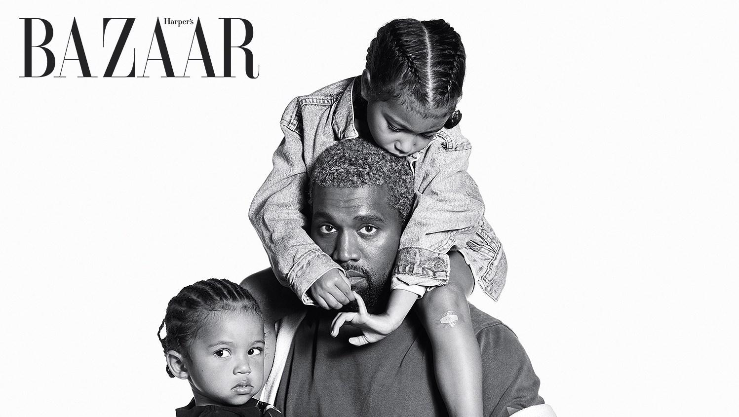 Kanye West holding North and Saint