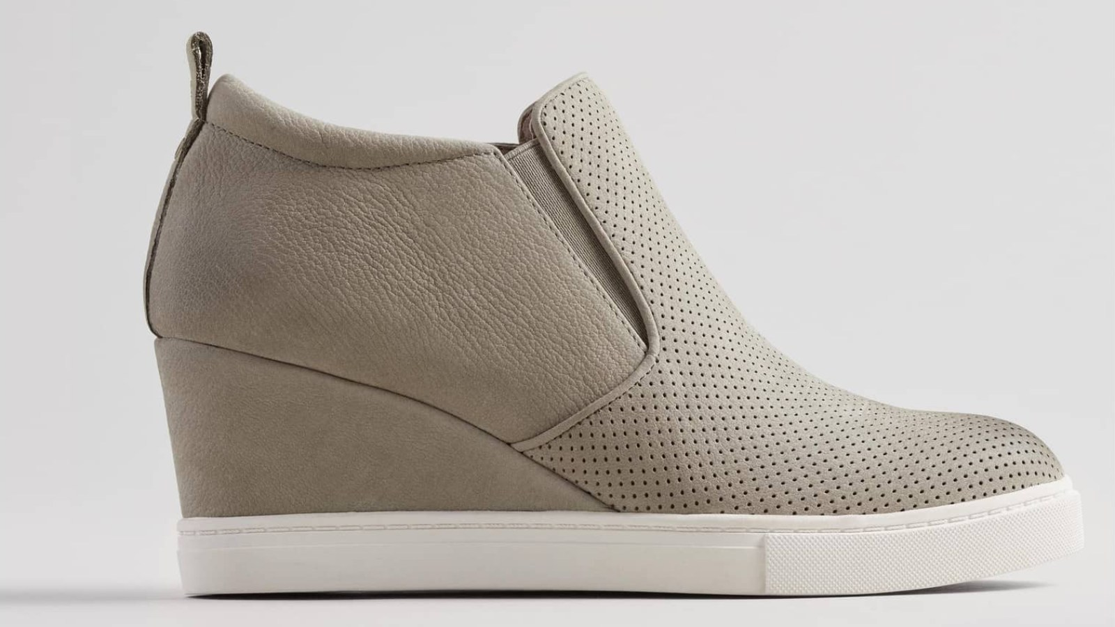 cfee8bd749f We re Fueling Our Wedge Sneaker Obsession With This Sporty Design